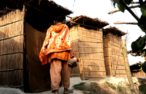 A CLP participant is using hygienic latrine