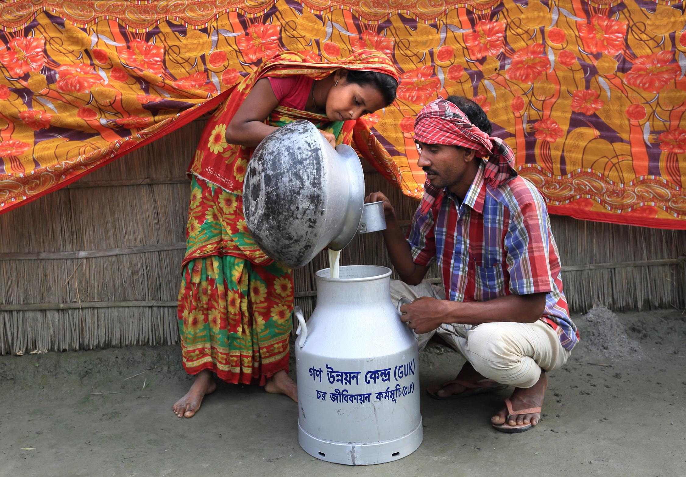 Participant selling milk to the Goala