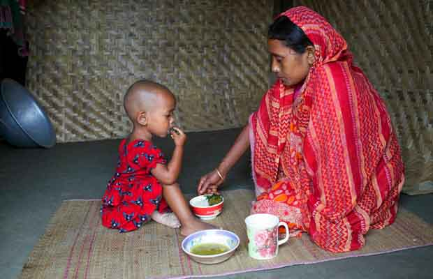 Mother feeding nutritious foods to her child